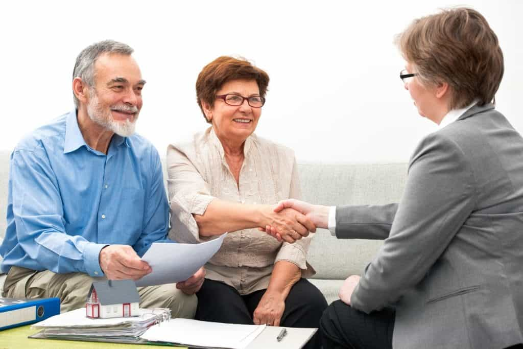 older couple meeting with real estate agent