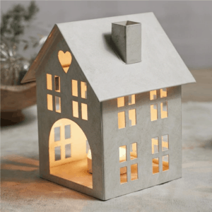 House-shaped candle holder with votive candle