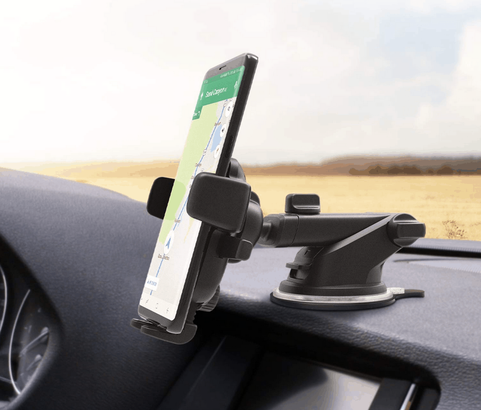 Smartphone mounted to car dash with adjustable suction mount