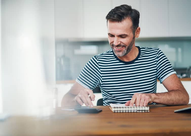 Man in casual clothing calculating real estate appraiser salary potential