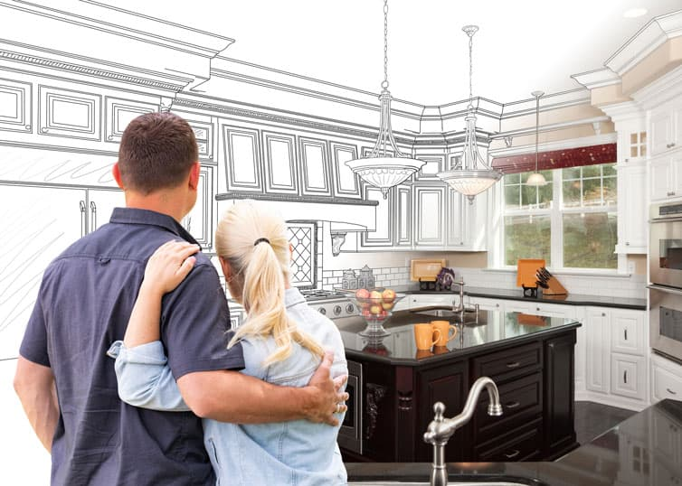 A middle aged couple envisions home renovations in their kitchen
