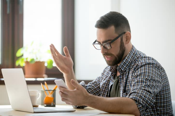 Appraiser reading frustrating emails from clients and AMCs