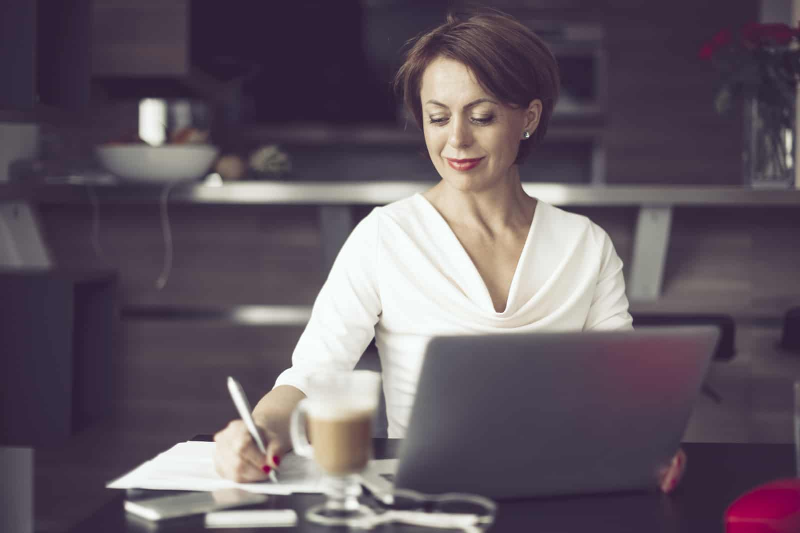 Female real estate appraiser working at home, preparing for a luxury home inspection